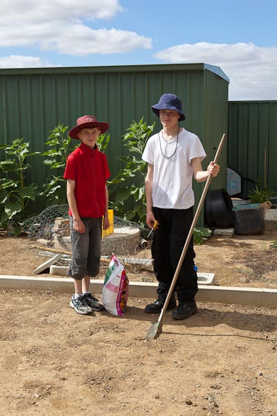 Our trusty child labourers, ready to spread the gypsum over the clay soil.