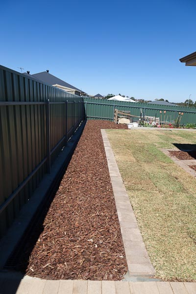 All mulched along the fence, ready for some plants!