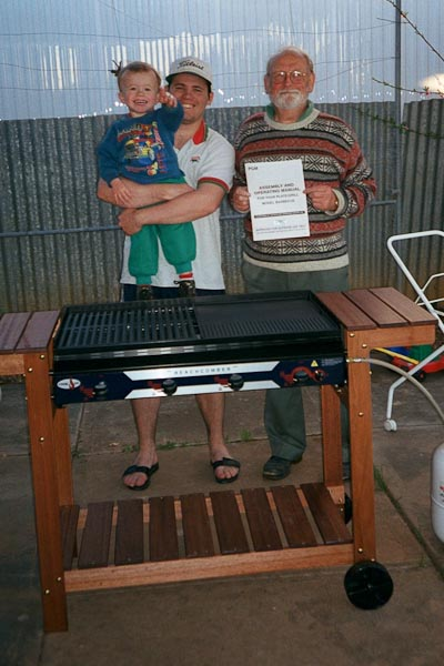Dad, DH, DS1 after they finished assembling our very first BBQ - a momentous moment!!